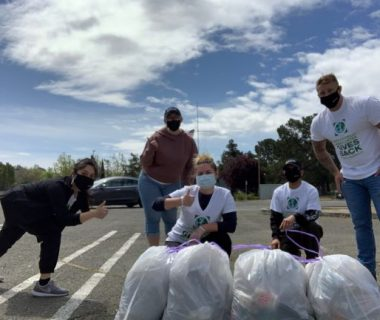 Employees participating in community clean up efforts.